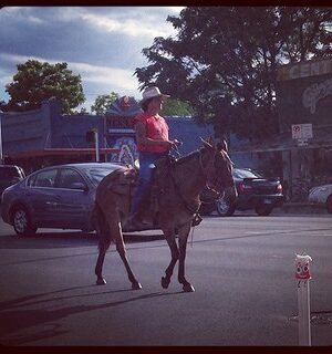 A woman on horseback at the BlogHer 2013 conference.