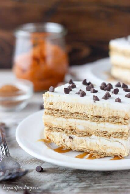 This no-bake Pumpkin Pie Lasagna is a quick and easy fall dessert to share. Layers of pumpkin mousse, whipped cream and graham crackers make this icebox cake the perfect fall dessert.