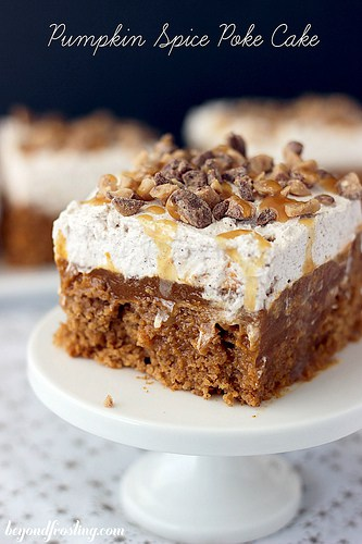 Double Pumpkin Spice Poke Cake | beyondfrosting.com | This Double Pumpkin Poke Cake features a spice cake soaked in pumpkin pudding and topped with a cinnamon maple whipped cream.