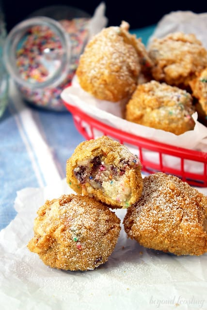 Deep Fried Cake Batter Dough Balls in a plastic basket and in front