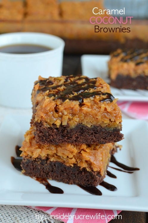 A Stack of Two Caramel Coconut Brownies Next to a Cup of Coffee