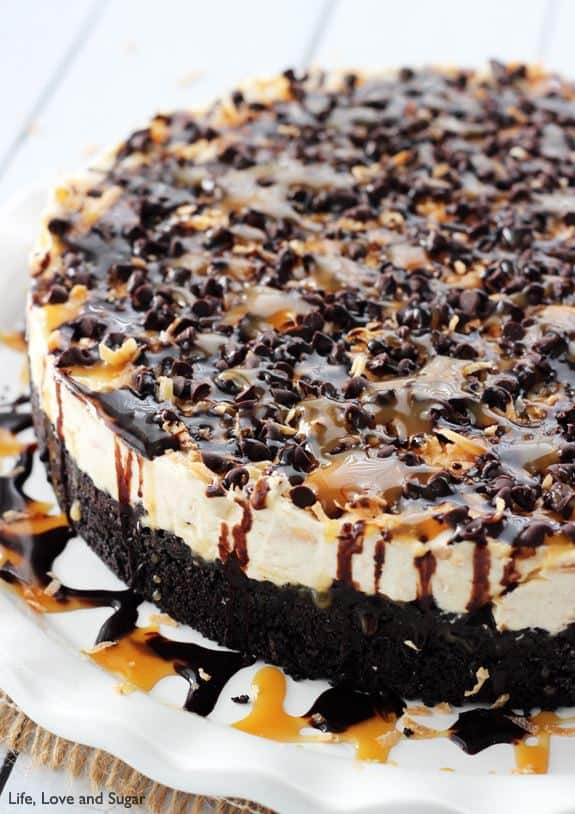 A Samoa Cheesecake Covered in Caramel and Chocolate Sauce