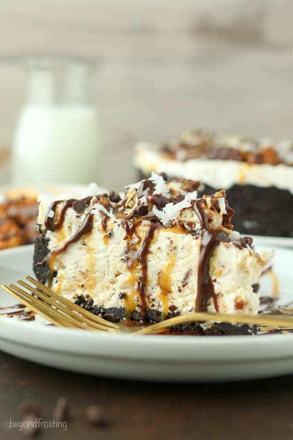This Samoa Cookie Ice Cream Pie is oozing caramel and coconut. This has an Oreo cookie crust, with a caramel and coconut ice cream filling stuffed with Samoa cookies.