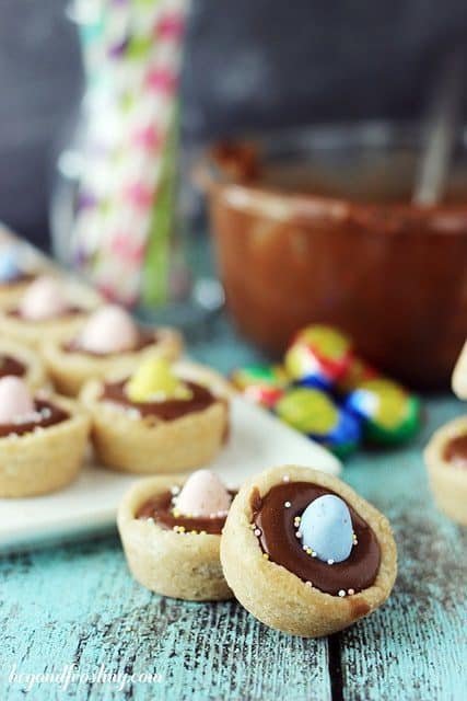 These cookie cups are filled with Cadbury ganache and topped with a candy egg.