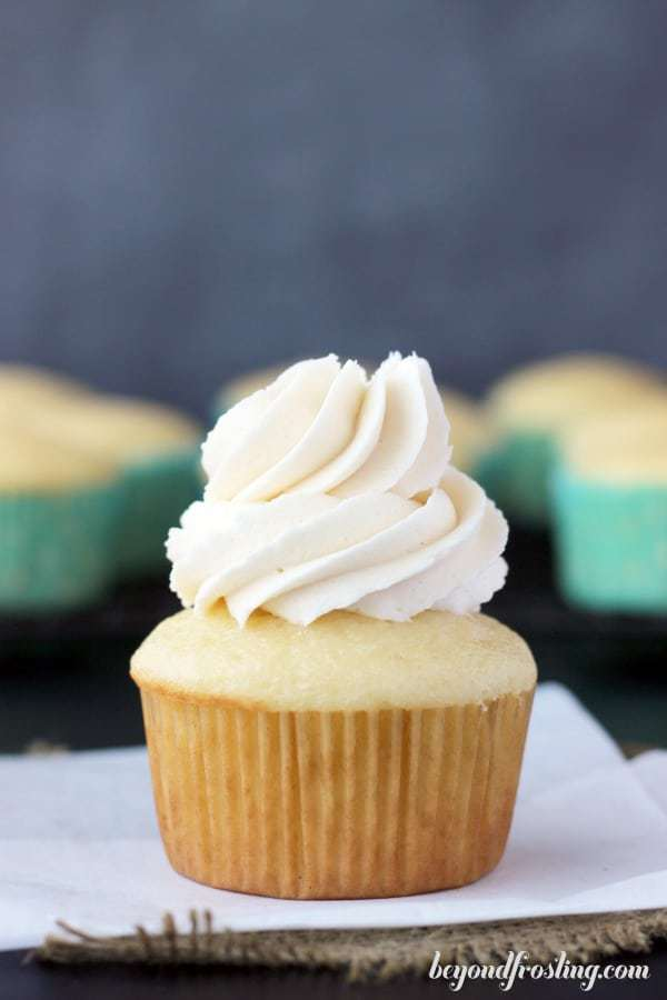 a cupcake frosting with vanilla frosting using an Ateco 844 piping tip