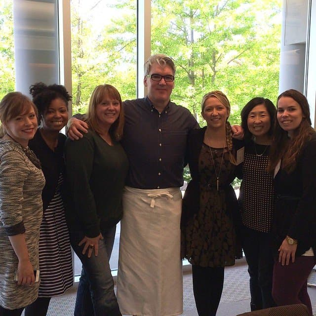 Food bloggers posing with Chef Peacott