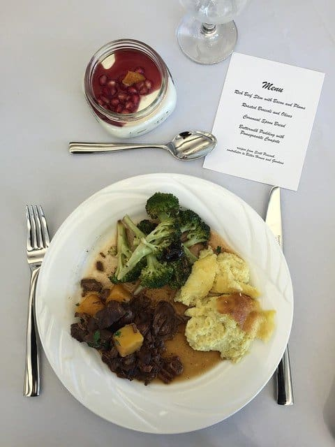 Overhead view of a plate of food and a menu from a BHG food demonstration