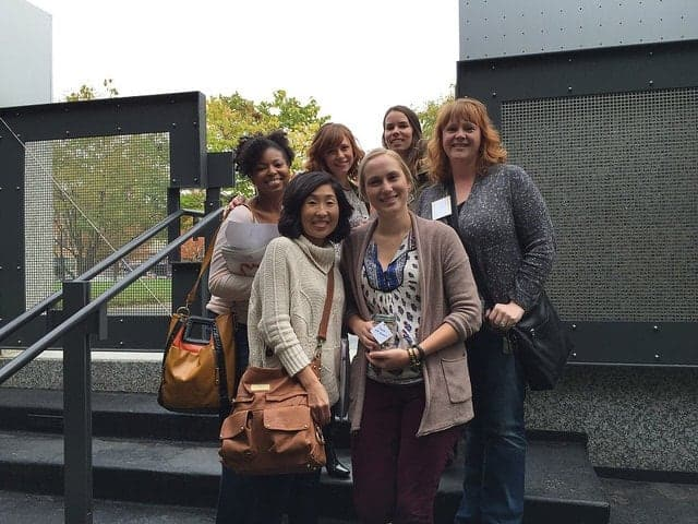 A group of food bloggers posing outside a building for the BHG Cooking Experience event