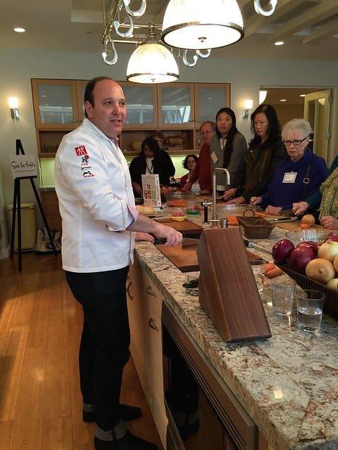 Chef Jeffery Elliot giving a knife demonstration in a kitchen