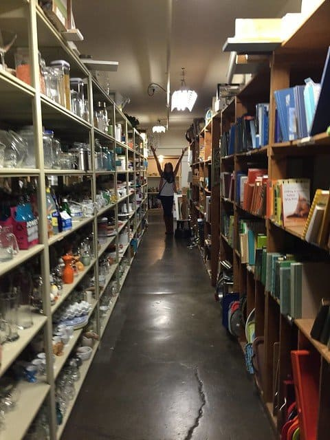 Shelves of kitchen accessories and books for food staging