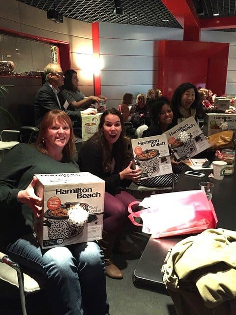 A group of food bloggers in an audience showing new slow cookers