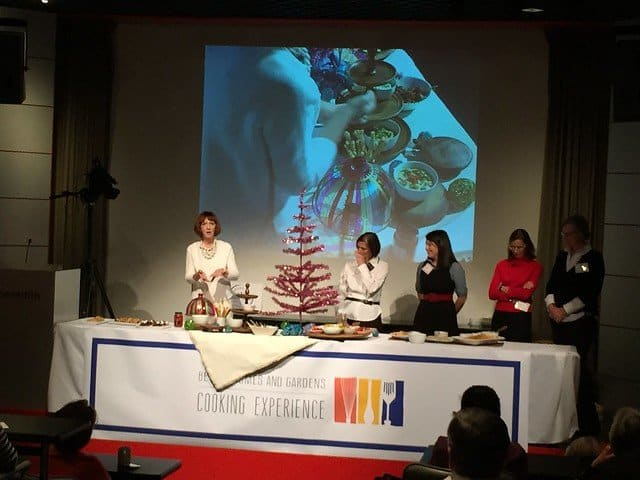 A food demonstration table with a pink tinsel tree at the BHG Cooking event