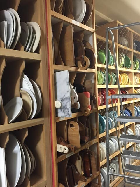 Shelves of cutting boards and colorful dishes