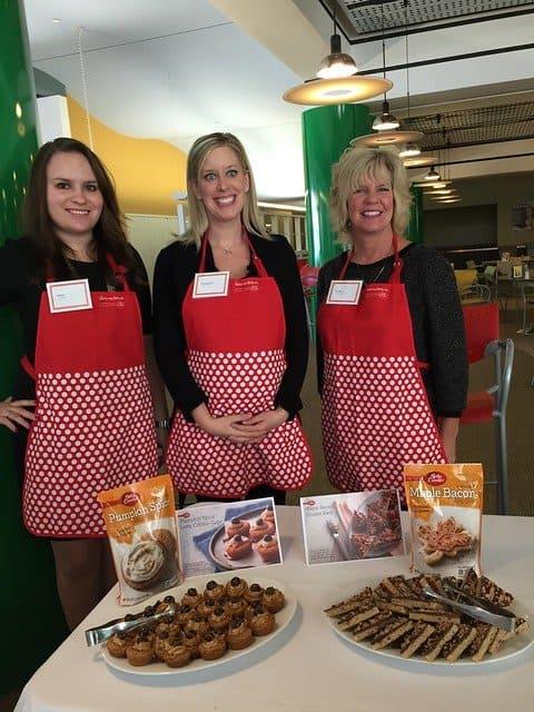 Three ladies posing with treats made from Betty Crocker mixes