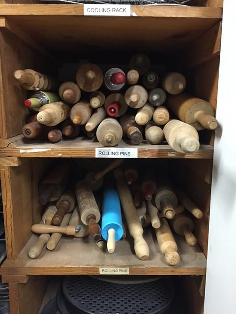 Two shelves of rolling pins