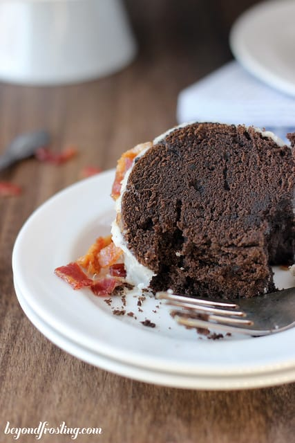 A slice of Maple Bourbon Chocolate cake on a plate with a fork