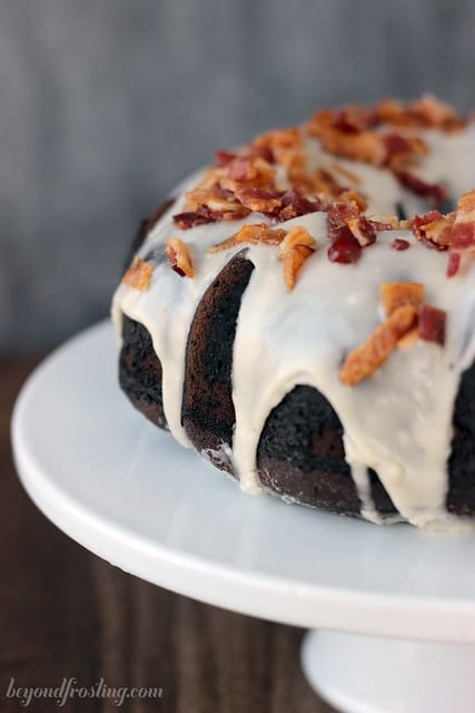 Close-up of a Maple Bourbon Chocolate cake on a white cake stand