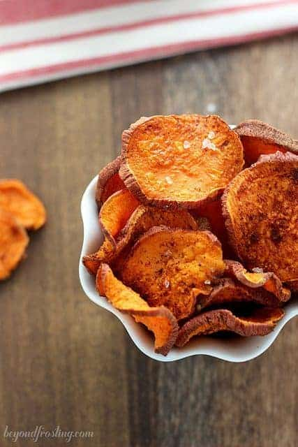 A bowl full of crispy cinnamon sugar baked sweet potato chips