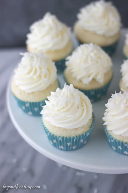 Overhead view of Coconut Cream Pie Cupcakes on a white cake stand