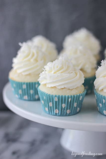 Coconut Cream Pie Cupcakes on a white cake stand