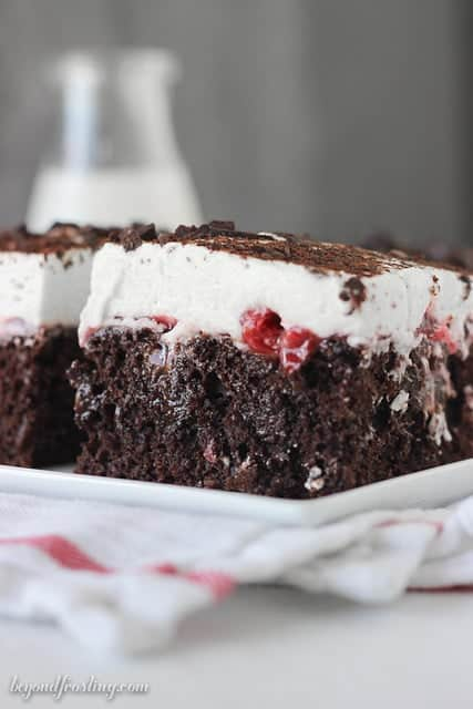 Mouth watering black forest poke cake. Dig in with a spoon.