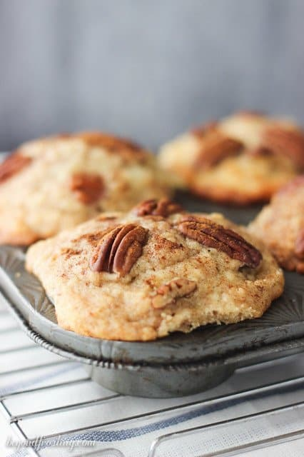 Close-up of Bakery Style Cinnamon Pecan Muffins in a tin