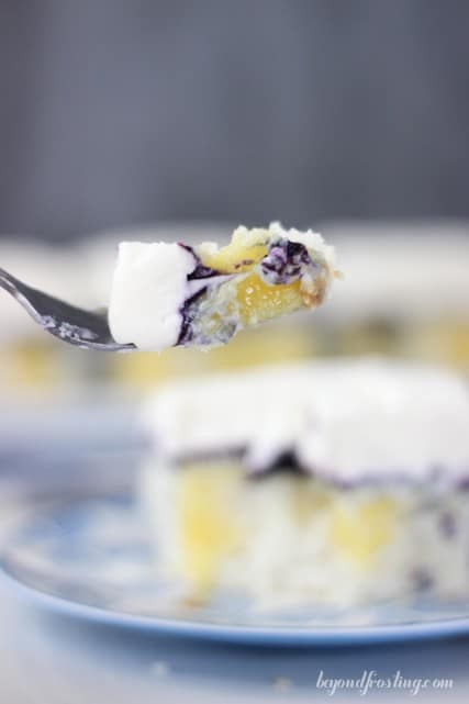 Enjoy every last bite of this Blueberry Cheesecake Poke Cake