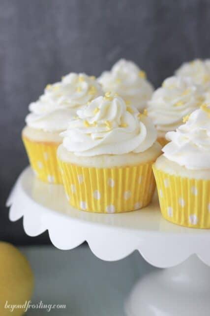 Lemon Cream Pie Cupcakes on a white cake stand