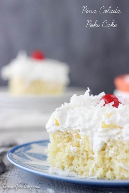 A Pina Colada Poke Cake is such a refreshing dessert! This rum spiked vanilla cake is drenched in sweetened condensed milk and topped fresh pineapple and coconut whipped cream.
