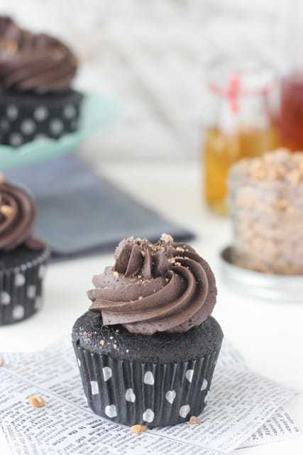 These Whiskey Toffee Chocolate Cupcakes are a surprise in every bite! A dense, whiskey infused chocolate cupcake filled with a spiked chocolate toffee ganache and topped with a whipped chocolate frosting.