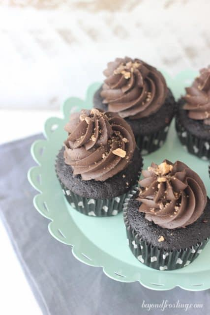 Enjoy every bite of these Whiskey infused chocolate cupcakes with a spiked toffee chocolate ganache.