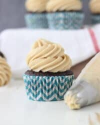 Biscoff Cheesecake Cupcakes- A chocolate cupcake with a layer of baked cheesecake inside topped with a Biscoff cream cheese frosting. You won't get enough of these cupcakes!