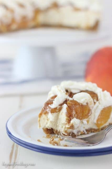 A brown sugar cheesecake in a vanilla wafer crust topped with brown sugar peaches and cinnamon.