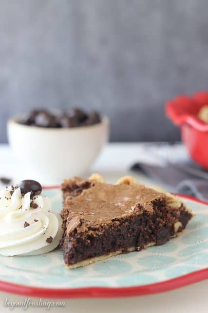 This Espresso Brownie Pie is flaky on the outside and fudgy in the middle. It is loaded with chocolate covered espresso beans