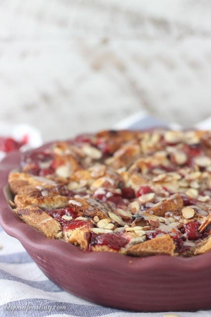 This Chocolate Almond Cherry Bread Pudding is baked to perfection with layers of chocolate almond milk-soaked bread, cherry pie filling and sprinkled with sliced almonds.
