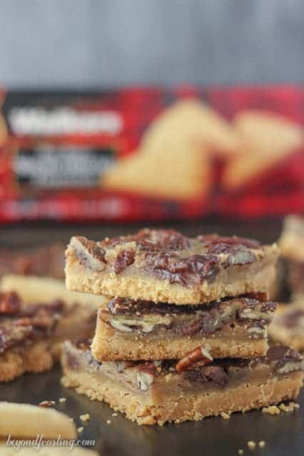 These Bourbon Pecan Pie Bars feature a buttery shortbread crust with a bourbon spike filling loaded with pecans and chocolate chips.
