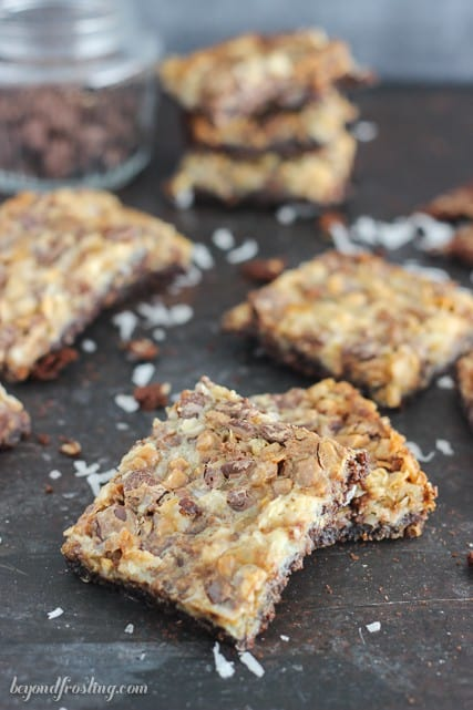 These Brownie Brittle Toffee Seven Layer Bars will wow your friends! A Brownie Brittle Toffee crust layered with coconut, walnuts, caramel chips and toffee.