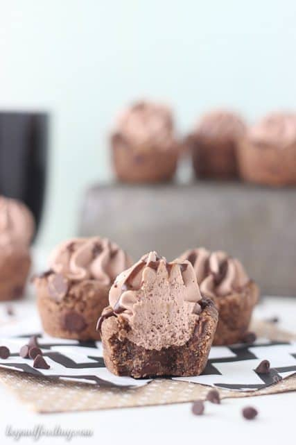 These Hot Chocolate Cookie Cups are a perfect treat to enjoy this winter. It's a hot chocolate cookie filled with hot chocolate whipped cream and drizzled with more chocolate.
