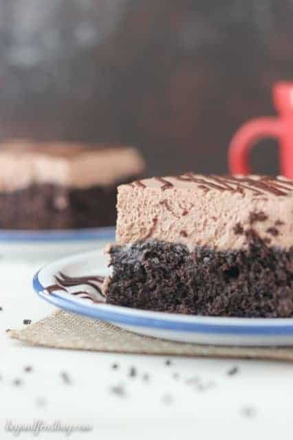 Mouthwatering and EASY chocolate cake made with hot chocolate powder and topped with hot chocolate whipped cream.