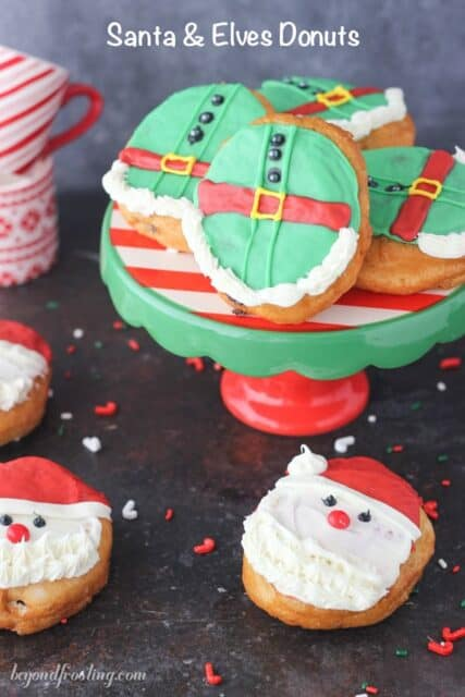These Santa and Elves Donuts are made with Pillsbury Grands Biscuits, filled with a chocolate buttercream and decorated santa heads and elves.