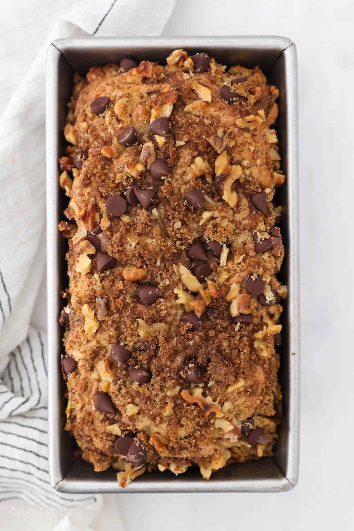 Freshly baked coffee cake topped with nuts and chocolate
