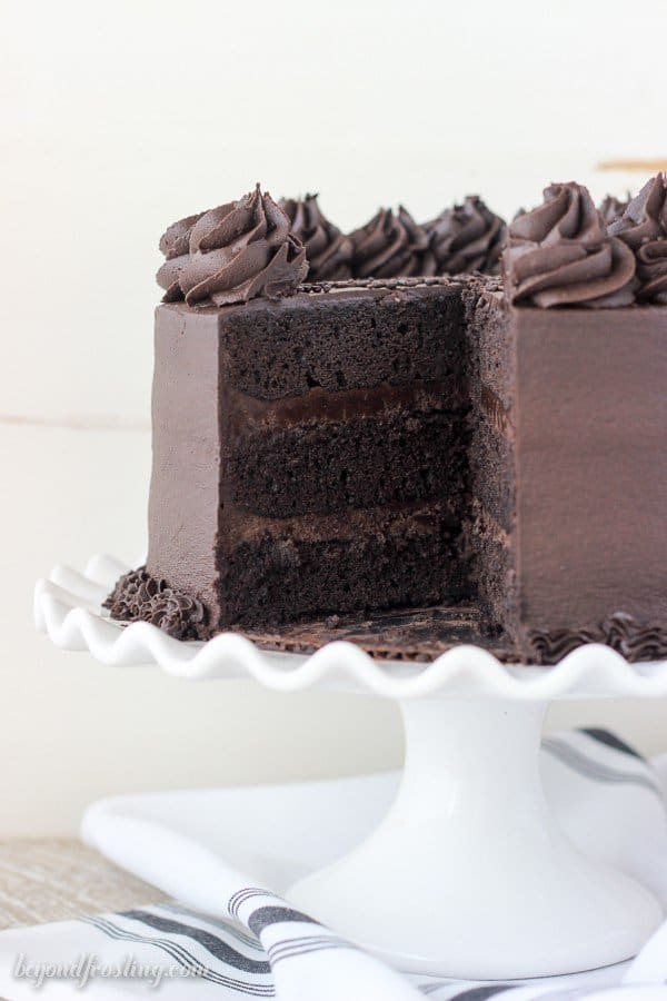 Homemade Chocolate Stout Cake on a white cake stand