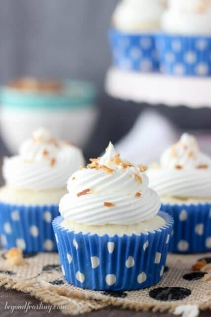 Skinny Coconut Cream Pie Cupcakes- a light coconut cupcake with coconut pudding and whipped cream.