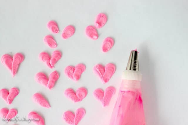 Easy buttercream hearts with a round tip.