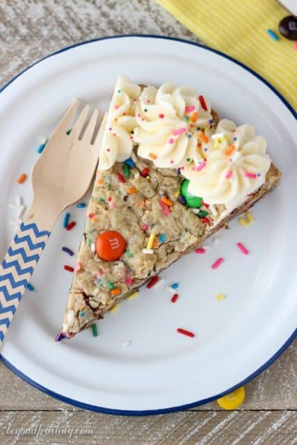 This Cake Batter Monster Cookie Cake is an cake batter oatmeal cookie with MnMs and sprinkles. It's topped with a little vanilla buttercream.