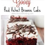 This Gooey Red Velvet Brownie Cake is seriously moutherwating. It's a classic red velvet cake mixed with a brownie. It's topped with a white chocolate cream cheese frosting. This is the best red velvet poke cake you've ever seen