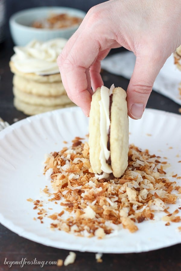 These caramel buttercream stuffed sugar cookies are also coated in hot fudge and rolled in toasted coconut. Get the recipe for Samoa Cookie Sandwiches at beyondfrosting.com