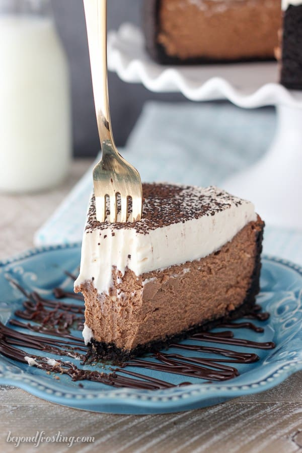 This easy Chocolate Cheesecake is spiked with Baileys Irish Cream. The homemade Baileys Whipped Cream is the icing on the cake!