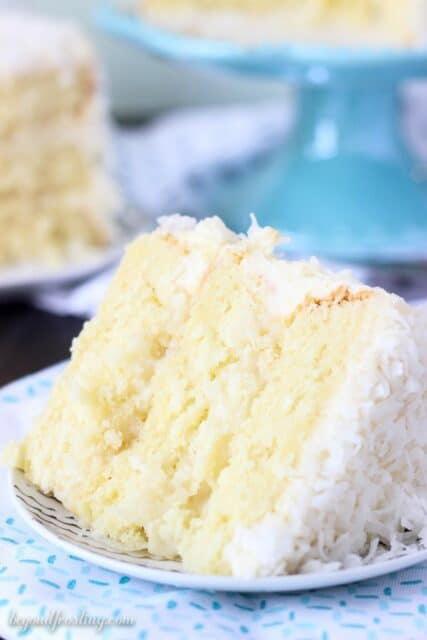 There's too much to love about this Coconut Custard Cake. Layers of coconut cake (from scratch), a simply coconut custard and finished with a cream cheese frosting. The whole cake is covered with sweetened coconut.