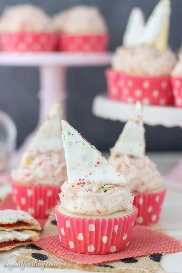 These Strawberry Pop Tart cupcakes are filled with a strawberry jam. The recipe for the Pop Tart Frosting is the best part!